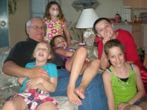 The grandkiddies climb all over Grandpa Ken (aka My-Heck-of-a-Guy, or MyHog for short).